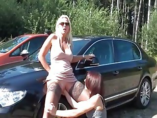 Horny blonde in stockings being fisted outdoors