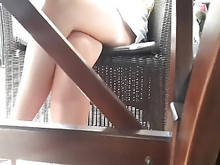 cute young Gf's crossed legs under table