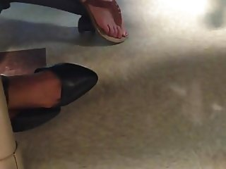 Pretty feet with shoe dangle