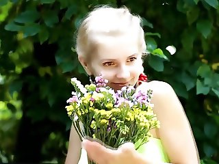 beautiful fresh blonde girl loves flowers
