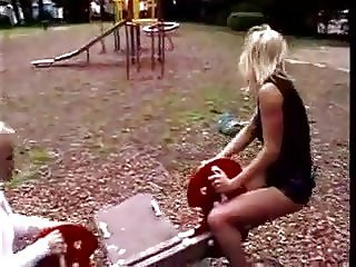 Amateur woman pissing on a swing jy