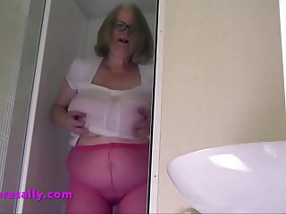 Sally soaks her tits in the shower