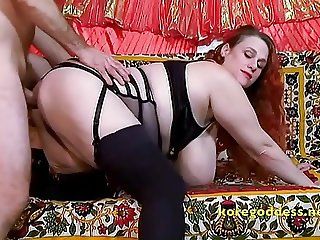 Bra busting redhead gets her ass fucked
