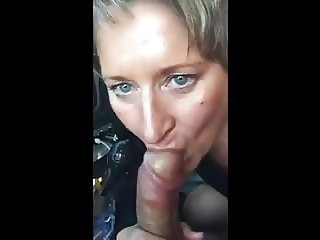 A mother sucks are young lover in car