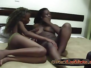 Black lesbians licking pussies on bed