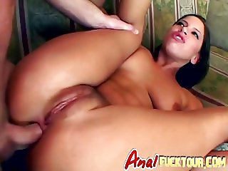 Brunette enjoys an ass to mouth action