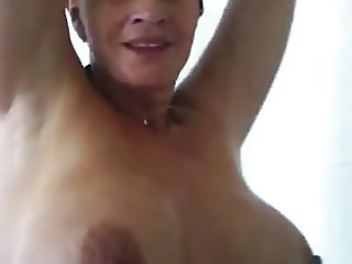 Shy mom exposing her huge tits