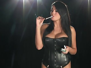 Smoking brunette in leather basque