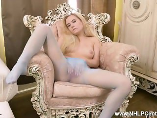 Cute blonde Lena Spanks strips off and masturbates in sheer nylon pantyhose