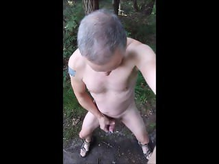 exhibitionist naked twink cruising in the woods with cumshot