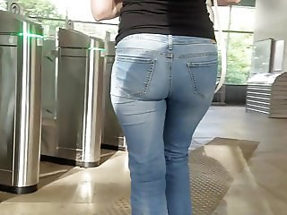 Behind the sweet girl with round ass