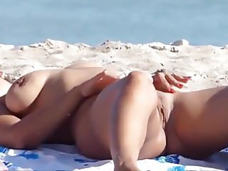 Beautiful blonde nude on a nudist beach