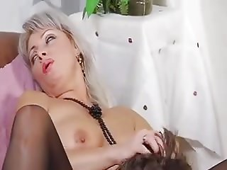 Young boy and mature blond