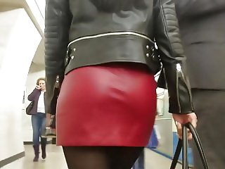 Sexy brunete's ass in red leather skirt