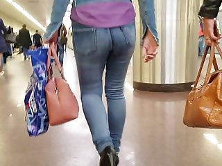 Young woman with hot round small ass in metro