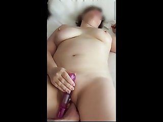 Mature wife masturbates with toy
