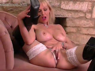 Blonde milf with big tits fingers pussy in slutty leather boots fishnets