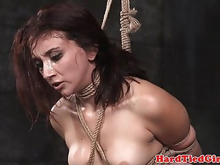 Tattooed bdsm sub tied up and pussy rubbed