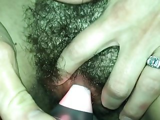 Cumshot on wifes tight hairy pussy while she musturbates