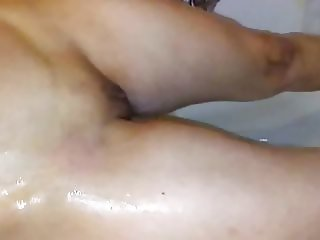 Wife rinsing pussy off in the shower