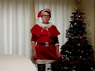 Mature MILF Suzy's Saucy Santa Striptease