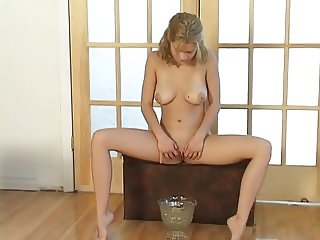 Christine Young pissing into a bowl