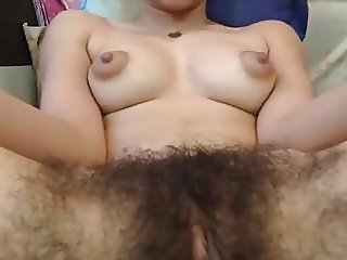 Hairy gal, puffy nips  fingering pussy