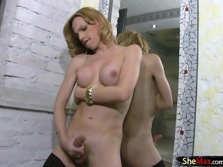 Slim and naughty tranny exposes her big tits in the mirror