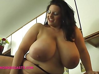 Wife with big hangers masturbates in the kitchen