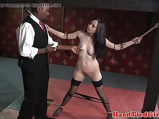 Maledom ties up sub for spanking and clamping