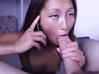 Asian Sucking Big Cock While Talkin On The Phone & Facial