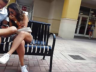 Candid voyeur hot girl in white shorts walking with bf