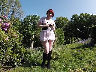 Redhead Wench in Boots outdoors flashing