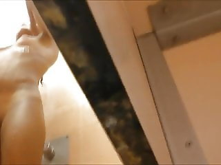 Spy and Voyeur Teen with shaved cunt in the bathroom