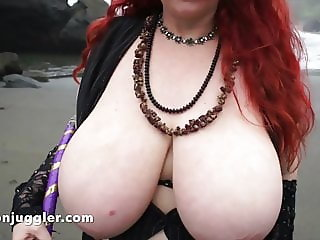 Redhead with big tits facialised at the beach