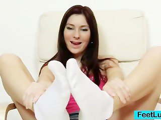 Charming brunette Kattie Gold cuddly feet and legs