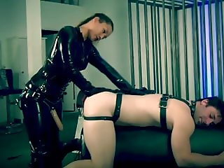 mistress  in latex catsuit fuck is strap on slave