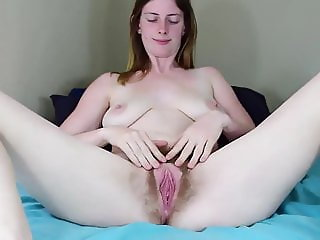 Amateur hairy girl creams her dildo