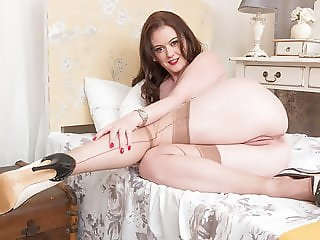 Big boobs natural brunette masturbates in retro nylons heels
