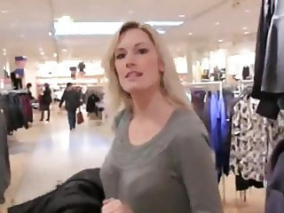 two busty german babes using strapon in pubic changing room