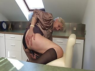 Granny caught masturbating in the kitchen!