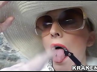 Rich woman in an outdoor BDSM scene with exhibitionism
