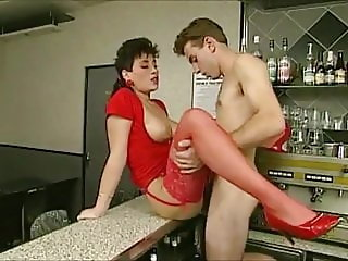 Belgian busty Brunette in red stockings lures him into sex