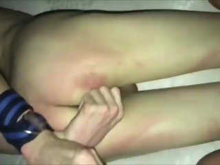 Whipping tied skinny Asian slave boy by belt till he cries