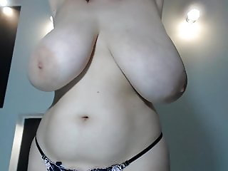 Blonde young cam girl with massive huge natural saggy tits