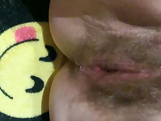 Spreading her hairy pussy