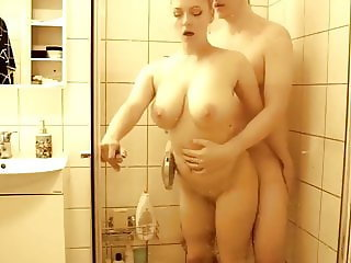 Naughty and Busty Bitch Shares Shower with Her Neighbor