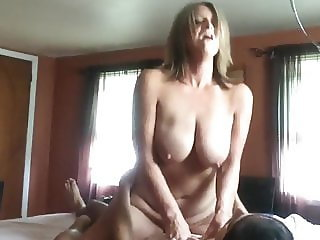 amazing mature wife with big tits rides her neighbor's cock
