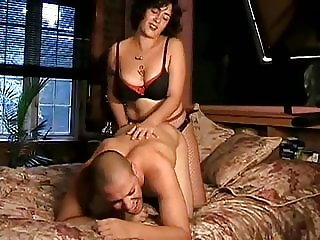 Girlfriend fucking him with a strapon on bed