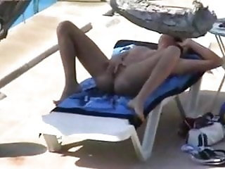 Fingering her pussy poolside